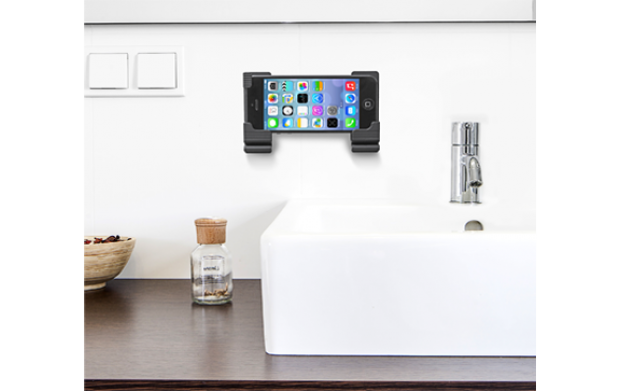 Soporte de pared para tablet y smartphone regulable